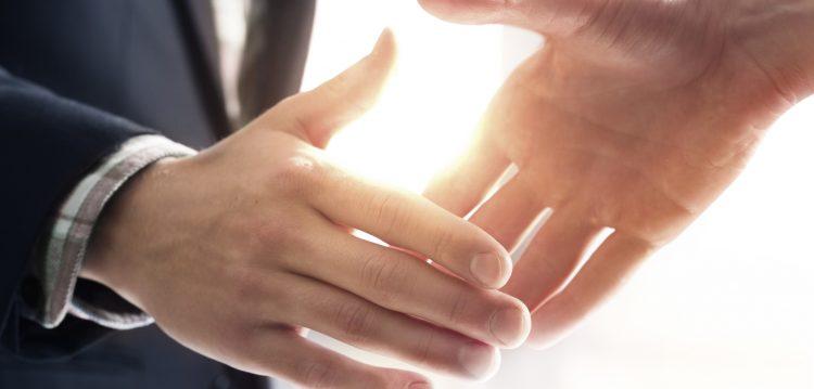 mutual handshake between two businessmen