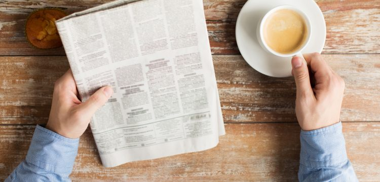 Newspaper and coffee on a desk