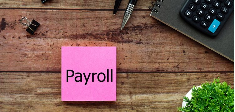 payroll-sticky-note-desk